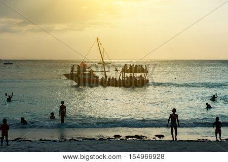 ZANZIBAR, TANZANIYA- JULY 09: beautiful seascape with touristic ship near beach at sunset on July 09, 2016 in Zanzibar