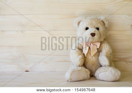 Teddy Bear On Wooden Floor