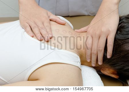 Physical therapist doing mobilisation of the spine