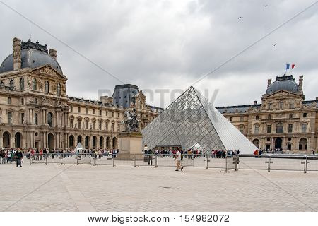 PARIS, FRANCE - april 22, 2016:The Louvre palace and Louvre pyramid. Louvre Museum is one of the largest and most visited museums worldwide