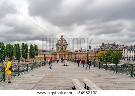 PARIS, FRANCE, MAY 16 2005. Bridge of arts, before fashion put padlocks on railings. In the background the Mazarine Library with the Academy of Fine Arts and the Academy of Science