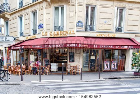 PARIS, FRANCE APRIL 23, 2016. Restaurant Le Cardinal located  at the corner  of Cardinal Lemoine Street and the Boulevard St Germain