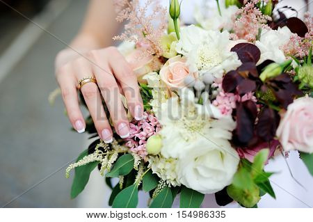 Bride's Hands With A Wedding Ring On A Finger