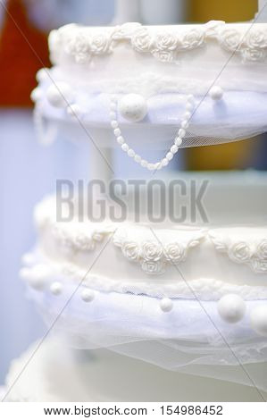 Wedding Cake Decorated With White Lace And Flowers