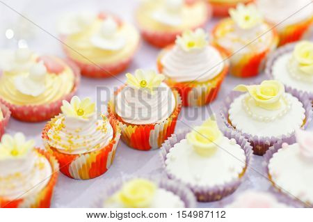 Decorated Cupcakes On A White Table