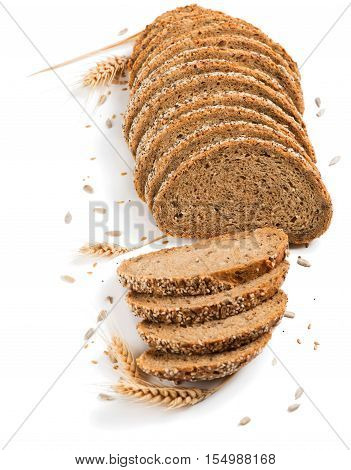 Slices of multigrain organic bread decorated with natural cereals isolated on white background.