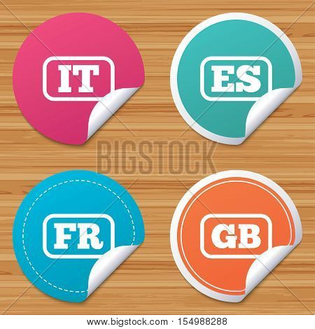 Round stickers or website banners. Language icons. IT, ES, FR and GB translation symbols. Italy, Spain, France and England languages. Circle badges with bended corner. Vector
