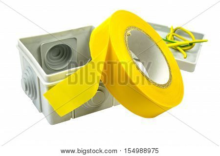 Yellow insulating tape and terminal box isolated on a white background