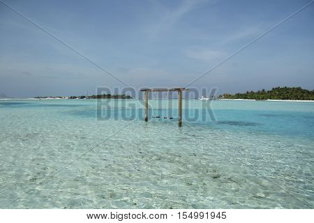 romantic swing straight into the turquise ocean water in Maldive beach
