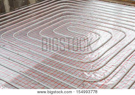 Underfloor heating installation. Close up on water floor system