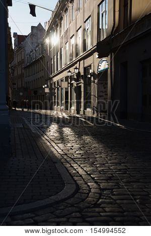 The cobbled streets of the old European city in the morning. Reflections on the pavement. Riga