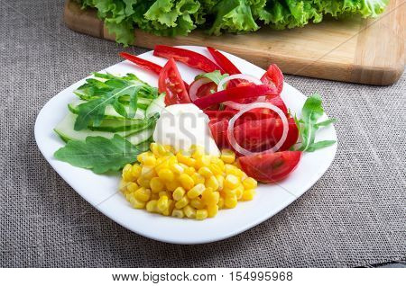 Natural Tomatoes, Bell-pepper, Mozzarella Cheese, Cucumbers, Corn, Lettuce And Ruccola
