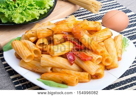 Dish Of Rigatoni Pasta And Ingredients For Cooking