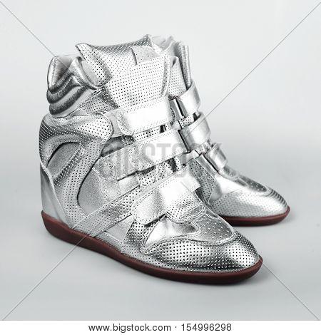 silver Italian shoes women in grey background