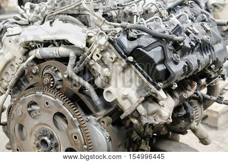 The image of a car engine with flywheel plate