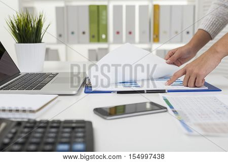 Businesswoman Is Working With A Graph On Desk