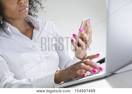 Pretty And Serious African Girl's Hand With Smartphone