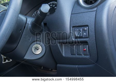 Ignition key of modern car close up. Car key in keyhole