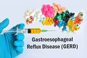 Syringe with drugs for gastroesophageal reflux disease (GERD) poster