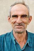 Elderly bald man, natural smile and positive grimace poster