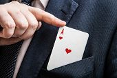 hand pulls the card ace of hearts close up poster