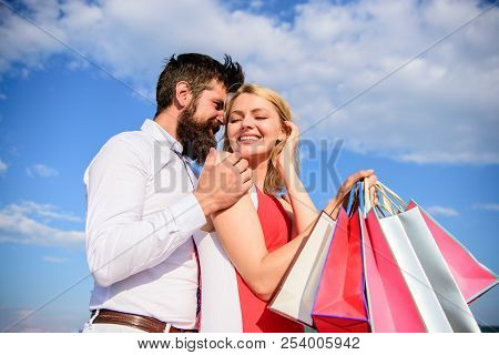 Shopping Brings Positive Emotions. Couple With Luxury Bags Hugs Blue Sky Background. Happy Couple Lu