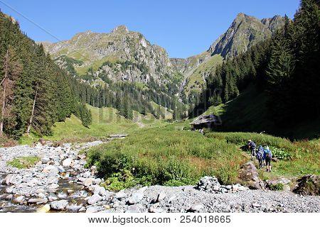 Valea Rea, Romania - August 11: People Trekking In The Mountains -valea Rea Trail To The Moldoveanu