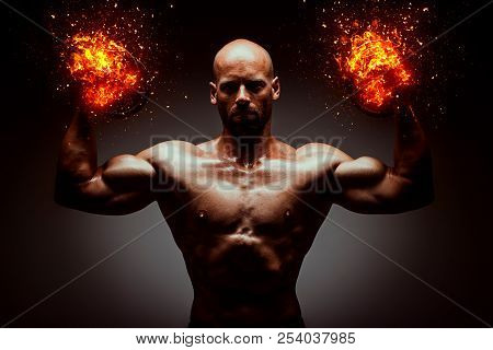 Strong Young Man With Muscular Body In Burning Black Sport Jacket With Hood. Concept Power Body