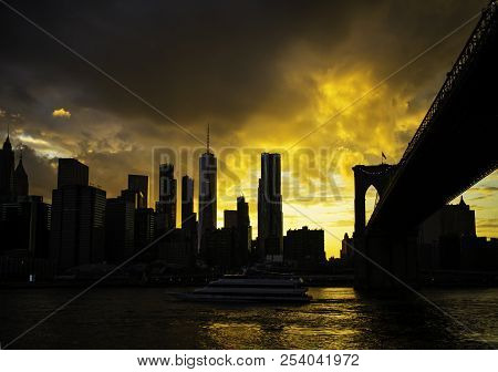 New York City Manhattan Downtown Skyline And Brooklyn Bridge At Sunset