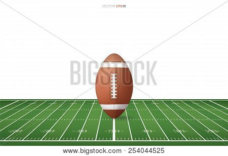 Football Ball On Football Field With Line Pattern Area For Background. Perspective Views Of Football