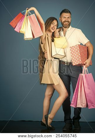 Black Friday, Happy Holiday, Relations. Shopping And Sale. Couple In Love Hold Shopping Bag Near Blu
