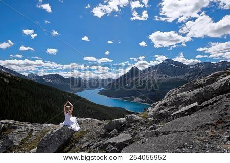 Mindfulness And Inner Peace. Meditation On Mountain Peak Above Blue Lake.  Scenic View Of Spray Lake