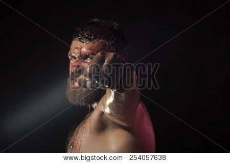 Fist With Blood Of Bearded Man On Black Background. Hipster With Beard, Mustache Shout With Anger. P