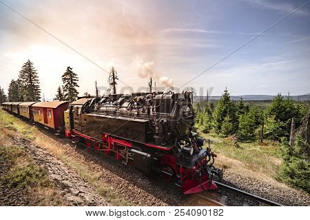 Steam Locomotive Driving Through Beautiful Nature In The Summer