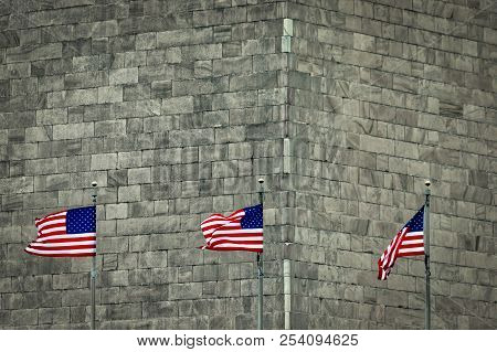 Three Flags Blowing In The Wind In Washington, Dc.