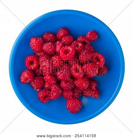 Raspberries On A Plate Isolated On White Background. Raspberries  Top View