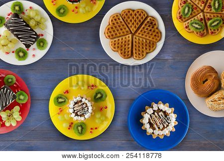 Cakes, Cookies Waffles On The Table