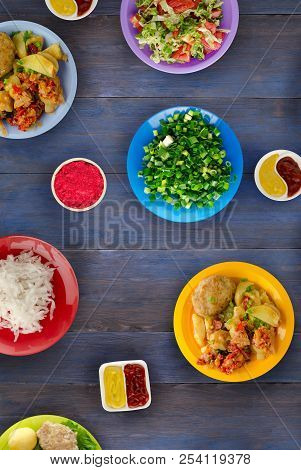Tasty Seasoned Fried Pork Chops Cooked In A Spicy Marinade Are Served With Boiled Potatoes, Salads A