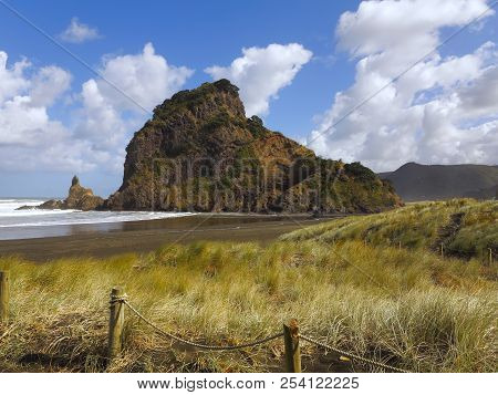 Brown Sand Sunny Beach. Green Mountainside Bathed In Sunlight. Blue Sky With Fluffy Clouds. Steep Mo
