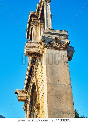 Arch of Hadrian or Hadrian`s gate, ancient monumental triumphal arched gateway with Corinthian columns at Leoforos Vasilisis Amalias, the major avenue in Athens. Attica, Greece. poster