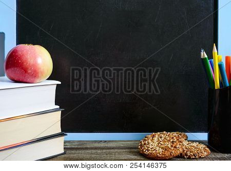Back To School, Education Concept. Book, School Supplies Useful, Whole-grain Cookies And Apple On Cl