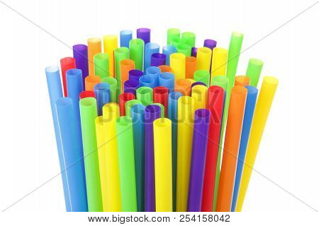 Many Colorful Plastic Straws With Opening Upwards Isolated On White Background. San Francisco Board