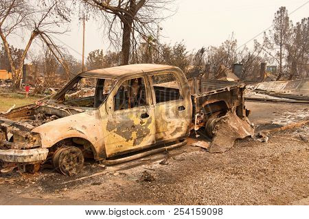 Charred Truck In Front Of Home Burned To The Ground In The Recent Wild Fire Fire Storm In Redding, C