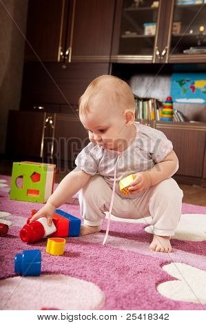Little Girl Playing On The Floor