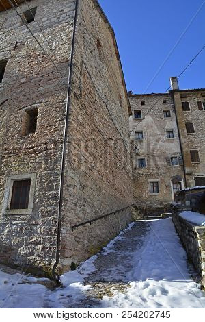 A street in the hill village of Casso in winter Friuli Venezia Giulia, north east Italy. With a population now of only 35, the village is famous locally for having being evacuated following the 1963 Vajont Dam disaster. poster