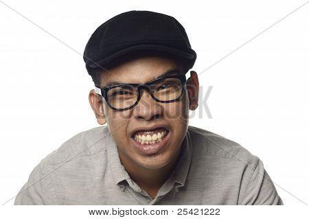 Angry malay man showing teeth