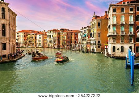 Sunset View Of Grand Canal With Gondolas And Boats In Venice, Italy
