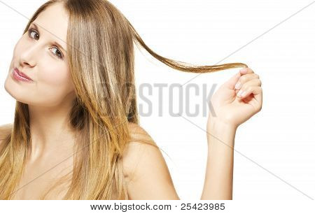 beautiful cheeky woman playing with her hair