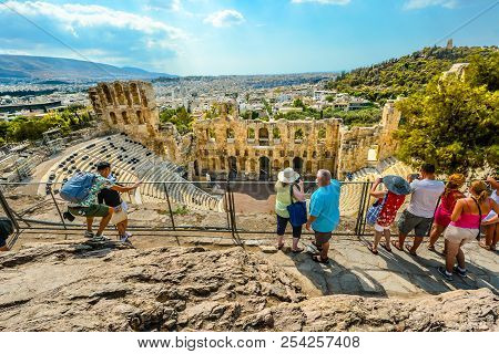 Athens, Greece - September 17 2017: Tourists Admire The Odeon Of Herodes Atticus, Or Greek Theatre,