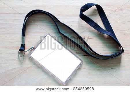 Blank Badge Mockup Isolated On Wooden. Lanyard And Badge. Plastic Badge. Template For Presentation O